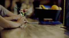 Two martini glasses with women's hands beside Stock Footage