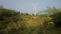 Colorful filming modern rustic idyll (pastoral) in India Wind farm Stock Footage