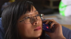 Female using telephone indoors Stock Footage