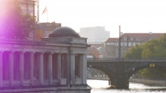 Locked down shot of Alte Nationalgalerie and busy train traffic in Berlin Stock Footage