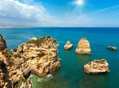 Sunshine above Atlantic rocky coastline (Algarve, Portugal). Stock Photos