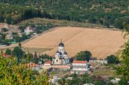 Landscape view with Capriana Monastery and the village around Stock Photos