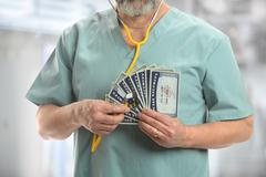 Doctor with Stethoscope on Generic Social Security Cards Kuvituskuvat
