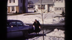 1959: woman walking from car carrying bags on slippery concrete HAGERSTOWN Stock Footage
