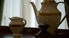 Tea sets in figurines over the cabinet in Ireland Stock Footage