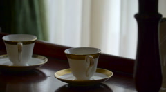 Two cup and saucer sets on the table in Ireland Stock Footage