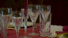 Crystal glasses on the center of the dining table in Ireland Stock Footage