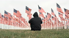 Man In Black Watching US Flags Stock Footage