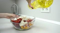 Vegetable oil into greek salad Stock Footage