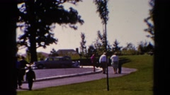 1962: everybody hustles toward the afternoon church event in the park CATSKILL Stock Footage