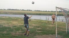 A man throws a soccer ball on his head boy. Football training Stock Footage