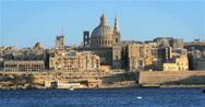 Valletta, Malta skyline at dusk; tilt reveal from sky to sea Stock Footage