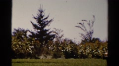1962: a pretty young woman outdoors preparing a table for a picnic CATSKILL Stock Footage