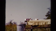 1962: table with cloth and bench arranged in an open place CATSKILL, NEW YORK Stock Footage