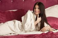 Brunette woman in white bathrobe Stock Photos