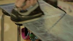 Snowboard being Waxed Closeup. Stock Footage
