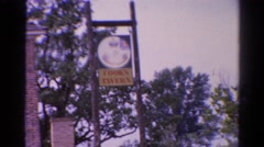 1962: building banner trees brick wall fence white huge CATSKILL, NEW YORK Stock Footage