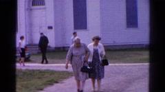 1962: a crowded, horse-drawn wagon passes by a building  Stock Footage