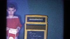 1962: christmas scene mother cheered indoor party presents many CATSKILL Stock Footage