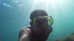 Man swimming underwater. Diving, man dives and swims under water. Go-Pro video. Stock Footage