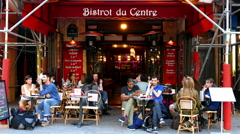 Paris, France. People relaxing outside a city bistro. Stock Footage