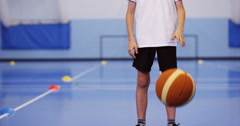 4k, Portrait of a young basketball player in the school gymnasium. Slow motion. Stock Footage