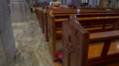 The edge of the benches inside the church in Ireland Stock Footage