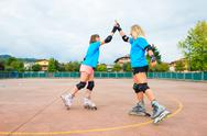 Two sports girl in a tennis Rollerblade give you clap their hands Stock Photos