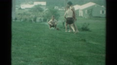 1962: brothers and sister playing and having fun with water in the backyard Stock Footage