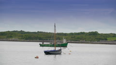 The landscape view of the sea and the boat in Ireland Stock Footage