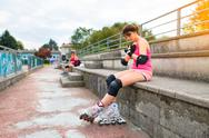 Girls are preparing to do rollerblading in the field Stock Photos