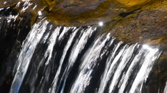 Brook water stream with small rift Stock Footage