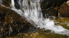 Waterfall stream of rapid water over rocky stones Stock Footage