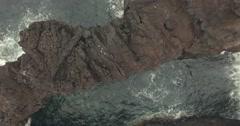 Flight over Volcanic ocean cliff Stock Footage