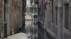Gondola passing small Canal in Venice Stock Footage