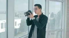 Realtor taking pictures of a real eatate and a window view Stock Footage