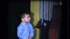 1951: a lonely child is missed looking around in a room CLEVELAND, OHIO Stock Footage
