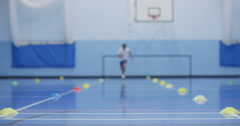 4K Determined young boy running laps & working hard in school P.E. class Stock Footage
