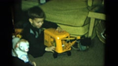 1951: boy playing with toy front loader CLEVELAND, OHIO Stock Footage