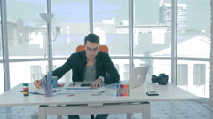 Young designer at his workplace developing a real estate mobile phone Stock Footage