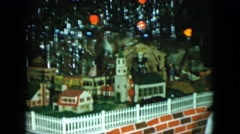 1951: a beautiful toy train moving around model city with buildings CLEVELAND Stock Footage