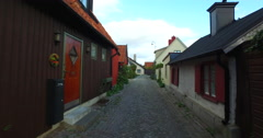 Small alley in the city of Visby on the island of Gotland in Sweden Stock Footage