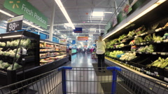 Woman shopper in fresh vegetable area of store 4K Stock Footage