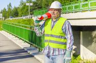 Road construction worker with traffic cone Stock Photos