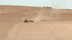 Tractor Cultivating Soil In Field Stock Footage