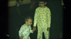 1951: children play indoor love siblings dressed toddler holding CLEVELAND, OHIO Stock Footage