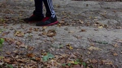 Man feet running in the woods Stock Footage