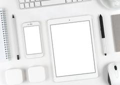 Responsive design: Keyboard, tablet and smartphone on white table Stock Photos