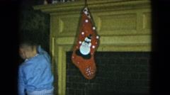 1951: young male child in pajamas putting up stockings CLEVELAND, OHIO Arkistovideo