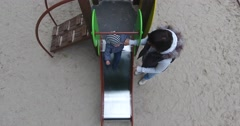 The women and child on the playground Stock Footage